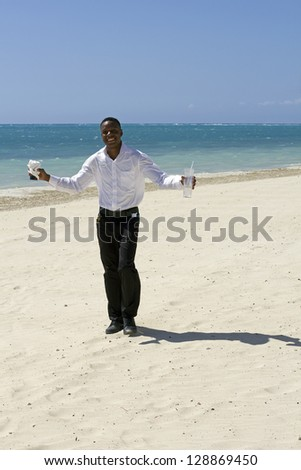 beautiful young jamaican waiter smiling on the beach