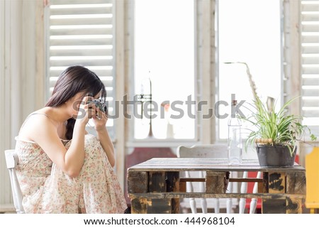 Beautiful Young Japanese Woman is taking photograph - stock photo