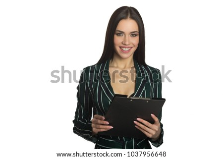 beautiful young joyful girl with dark hair in stylish clothes on a white background with a black folder in hands