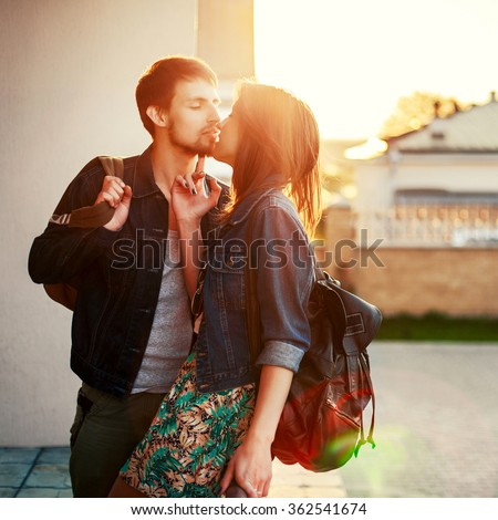 https://thumb1.shutterstock.com/display_pic_with_logo/952708/362541674/stock-photo-beautiful-young-kissing-couple-stylish-look-hipster-style-outdoor-summer-portrait-362541674.jpg