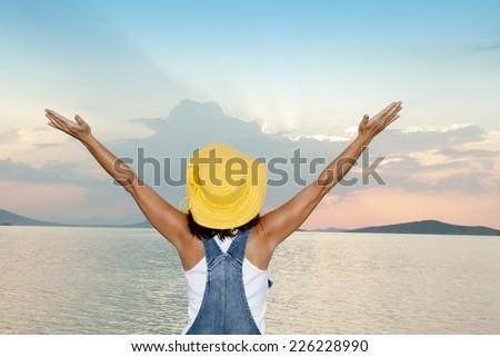 Beautiful young lady at sunset  - stock photo