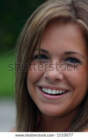 beautiful young lady looking directly with smile