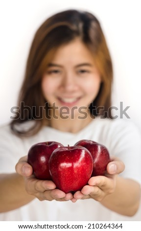Beautiful young lady showing  red apple  isolated on white.