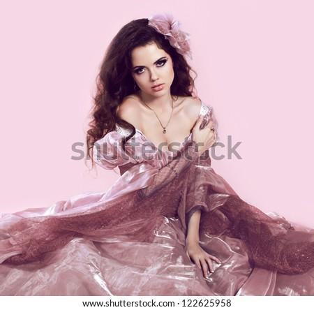 Beautiful young lady wearing elegant dress - stock photo