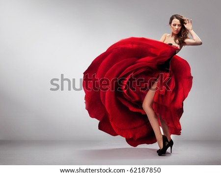 Beautiful young lady wearing red rose dress - stock photo