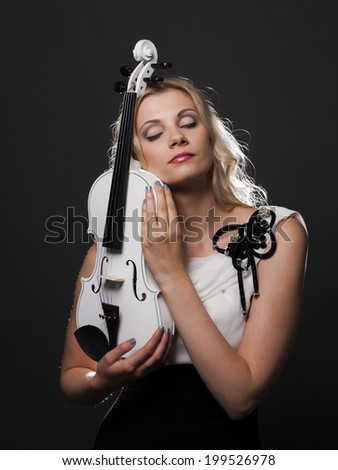 Beautiful young lady with her violin