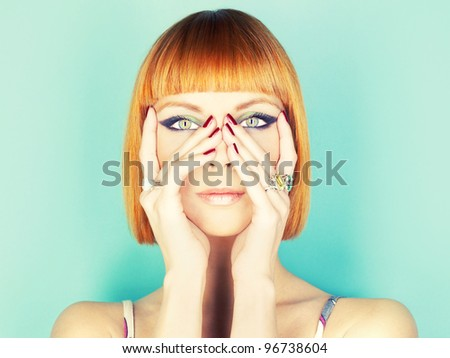 Beautiful young lady with red-haired bob - stock photo