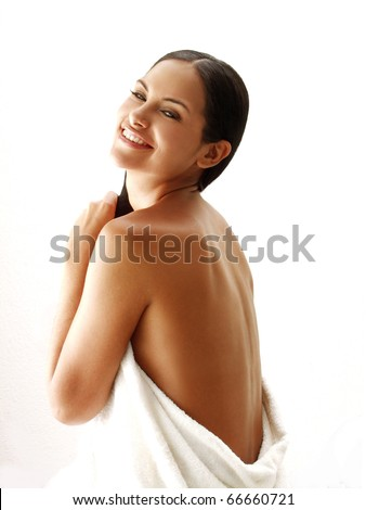 Beautiful young latin woman on white background.