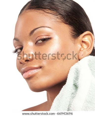Beautiful young latin woman on white background. Closeup portrait of young beautiful woman and towel after bath - spa. - stock photo
