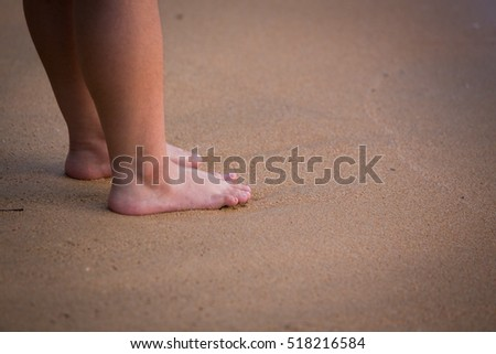 Beautiful young legs, walking on the beach.Thailand, Asia.