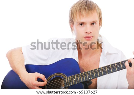 Beautiful young man plays guitar, isolated on white background. - stock photo