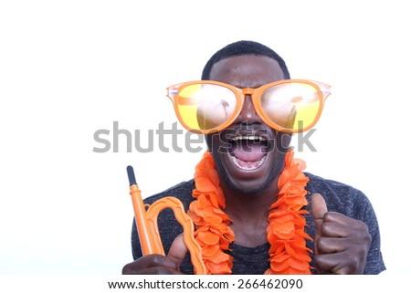 Beautiful young man with orange stuff - stock photo