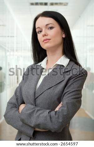 beautiful young manager standing in the office hall