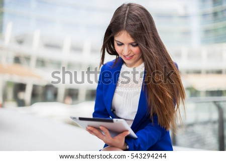 Beautiful young manager using a digital tablet outdoor
