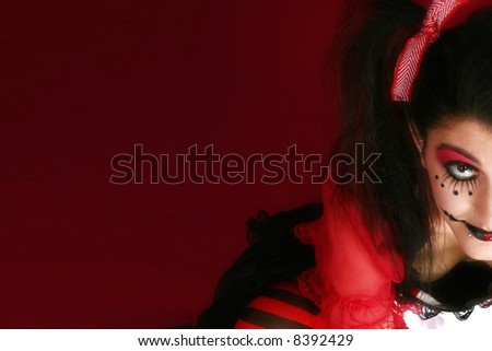 Beautiful young Middle Eastern woman dressed as goth doll. - stock photo