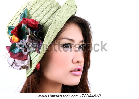 Beautiful young model in hat on the white background. - stock photo