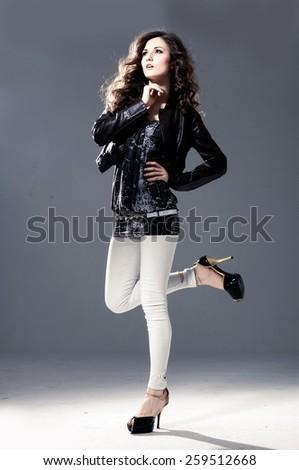 beautiful young model posing in the studio - stock photo