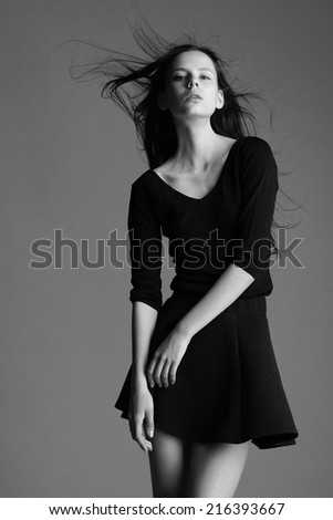 beautiful young model posing in the studio with different emotions. black and white photo.