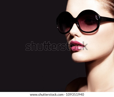 Beautiful young model with big glasses-close up - stock photo
