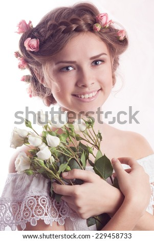 Beautiful Young model with floral delicate hairstyle