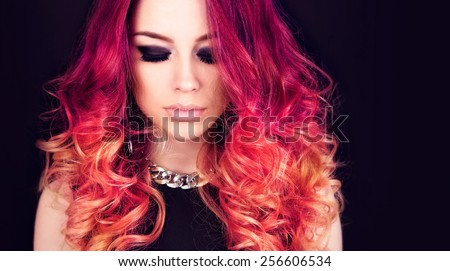 Beautiful young model with long curled hair - stock photo