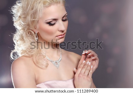 Beautiful young model with make-up and manicure, hairstyle - stock photo