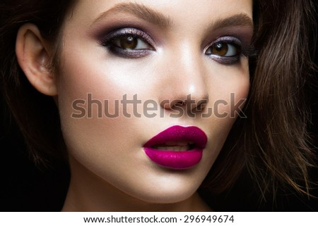 Beautiful young model with pink lips - stock photo