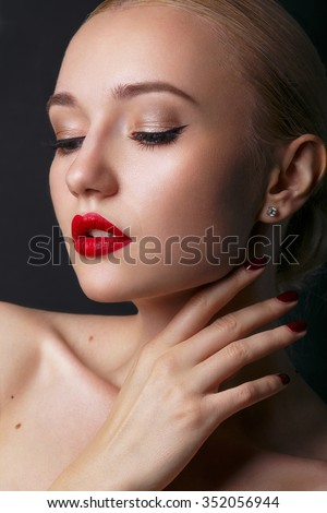 Beautiful young model with red lips and blond hair. Gorgeous Woman Face.  Perfect makeup. Beauty fashion . - stock photo