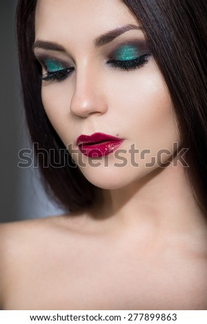 Beautiful young model with red lips and perfect makeup