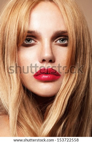 Beautiful young model with red lips sunburn skin