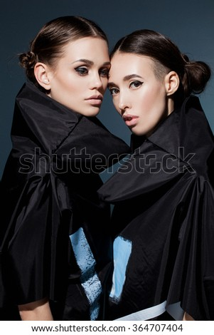 Beautiful young models  posing in the studio - stock photo