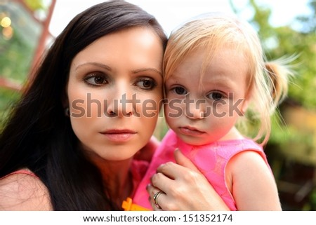 beautiful young mother and daughter  - stock photo
