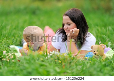 Beautiful young mother and daughter in the park