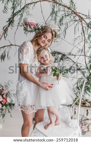 Beautiful young mother and here little princess  - stock photo