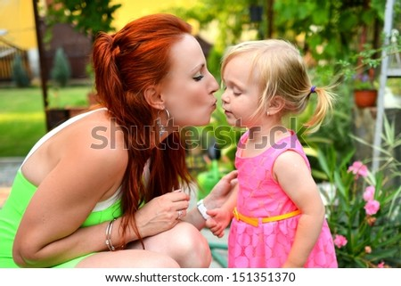beautiful young mother daughter relaxing  - stock photo
