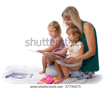 beautiful young mother with children reading a book