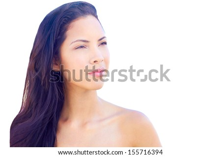 Beautiful young multi ethnic fashion model near the sea with clear skin and flowing long hair - stock photo