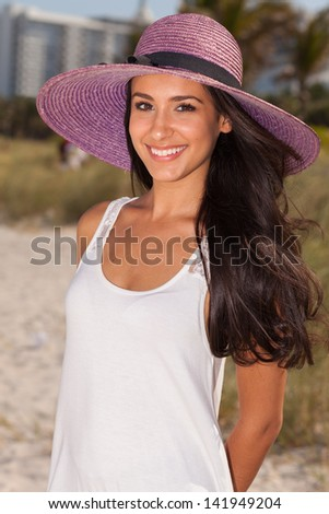 Beautiful young multicultural woman enjoying the beach. - stock photo