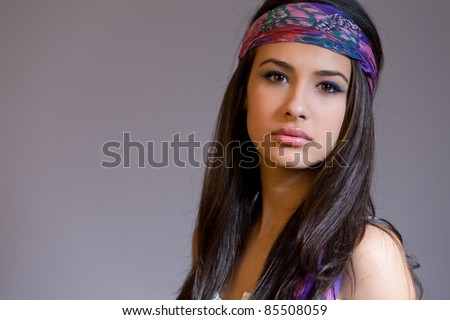 Beautiful young multicultural woman wearing a bandana. - stock photo