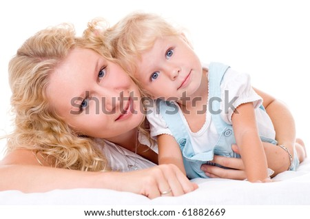 Beautiful, young mum and her daughter with blonde hair, isolated