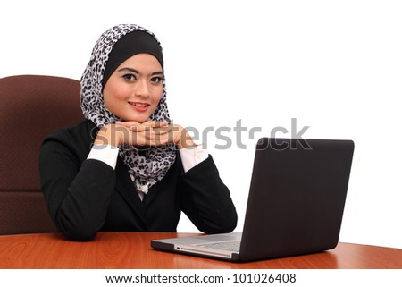 Beautiful young muslim business woman with laptop in office isolated on white
