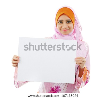 Beautiful Young Muslim girl holding a white card board over white background - stock photo