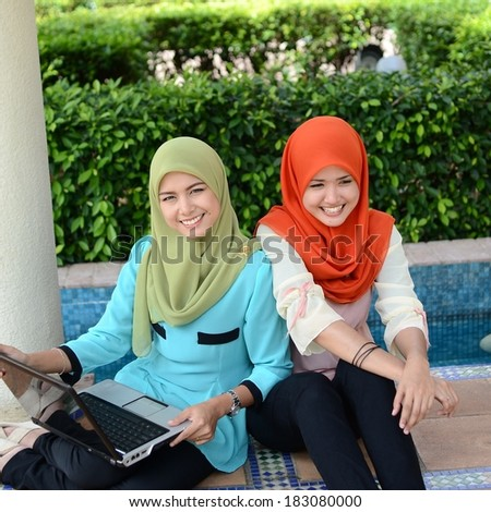 beautiful young muslim student happy while discuss study together