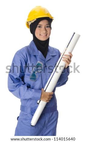 Beautiful young Muslim woman as architect. - stock photo