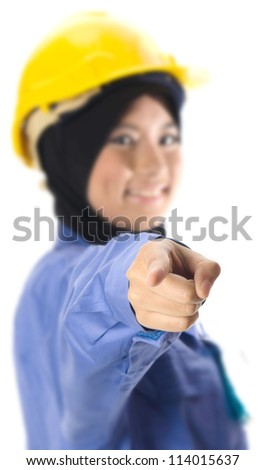 Beautiful young Muslim woman pointing finger.