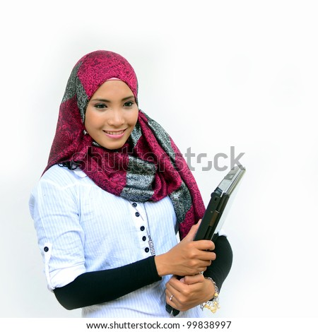 Beautiful young muslim woman smile with laptop isolated white background