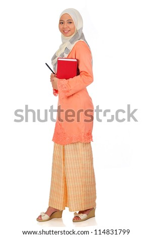 Beautiful young muslim women pose with a book. Isolated on white background.