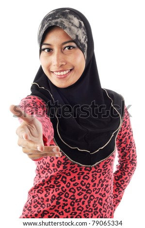 Beautiful young muslim women smile while extend her hand isolated white background - stock photo