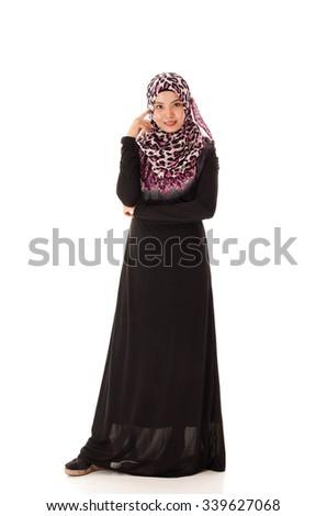 Beautiful Young Muslimah fashion pose isolated on white background - stock photo