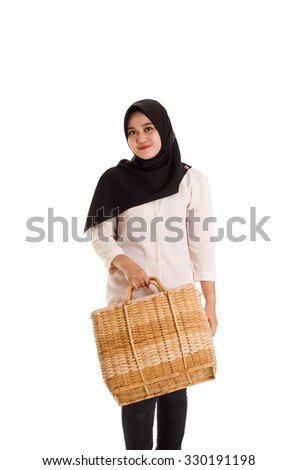 Beautiful Young Muslimah fashion pose with a basket isolated on white background - stock photo